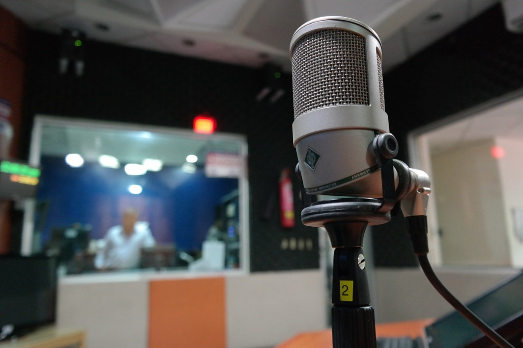 Use a professional microphone to record audio for online training modules.